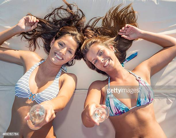Beautiful Women drinking Champagne on a Boat Deck