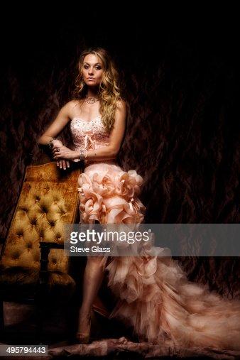 Beautiful women in studio in a gorgerous gown