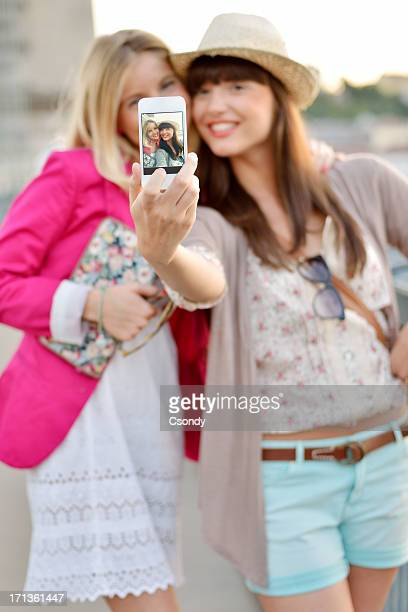 Beautiful women making selfie with smartphone