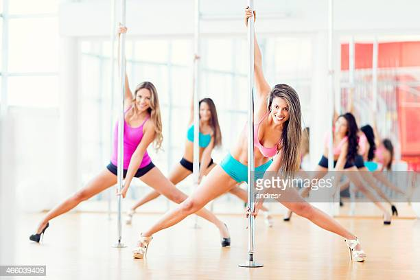 Beautiful women pole dancing