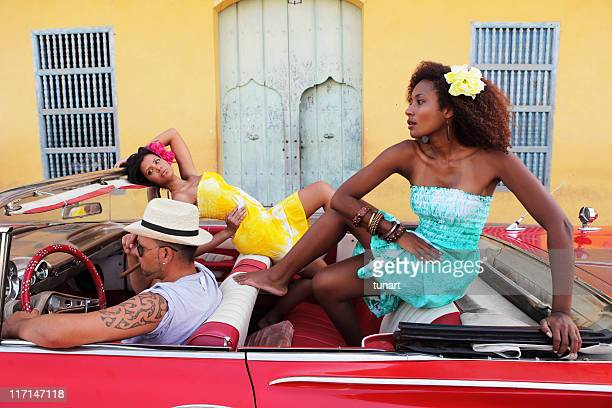 Beautiful women posing in an antique car in Trinidad, Cuba