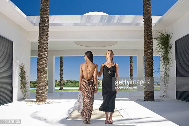 Beautiful women standing in modern villa