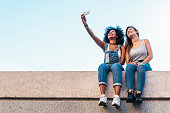 Beautiful women taking a self portrait in the Street. Youth concept.