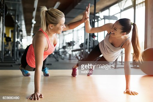 Beautiful women working out in gym : ストックフォト