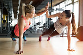 Beautiful women working out in gym together