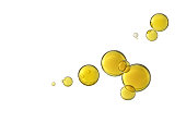 Beautiful yellow olive oil bubbles isolated over a white background.