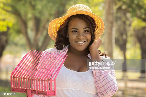 Beautiful young black woman visiting the farm