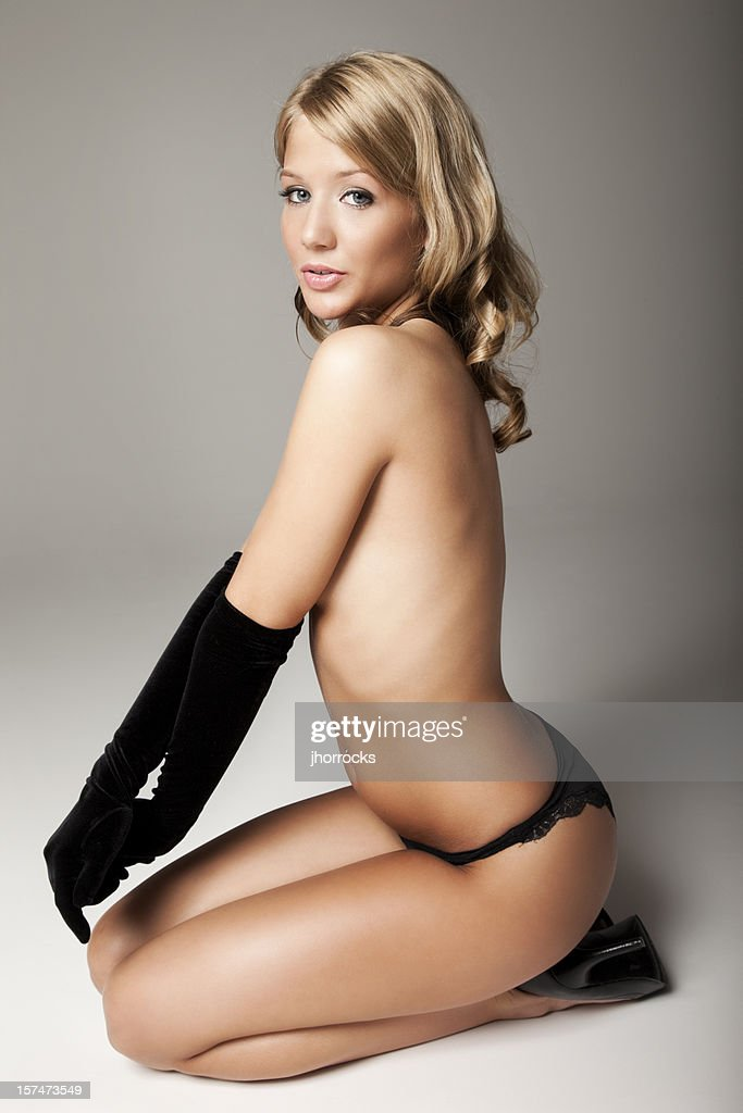 Beautiful Young Blonde Woman In Black Gloves Stock Photo ...