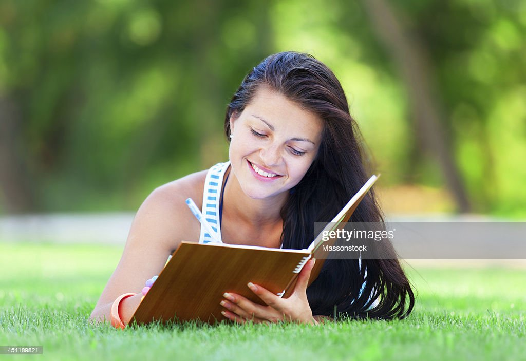 beautiful young brunette woman with note at outdoor : Stock Photo