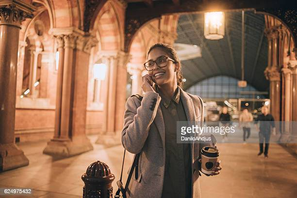 beautiful young businesswoman talking on her smartphone