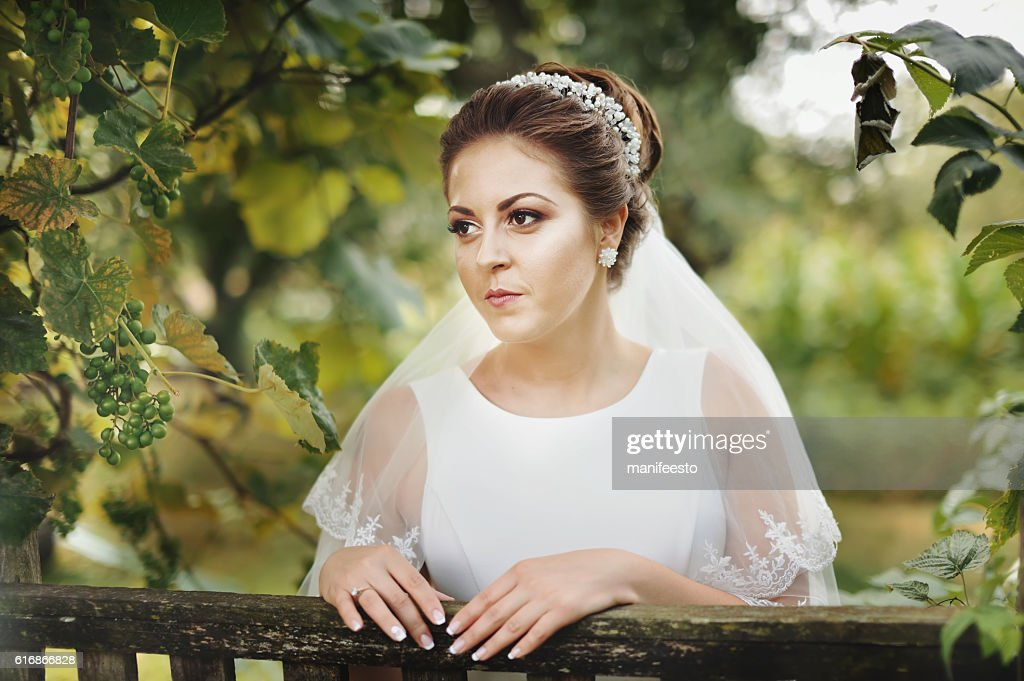 Beautiful young caucasian bride at countryside : Stock Photo