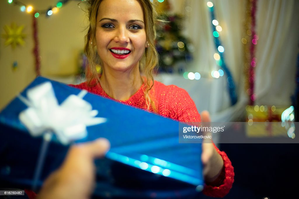 Beautiful young Christmas girl with gift. Happy New Year. : Stock Photo