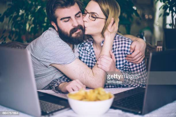 Beautiful young couple celebrate succsessful working day