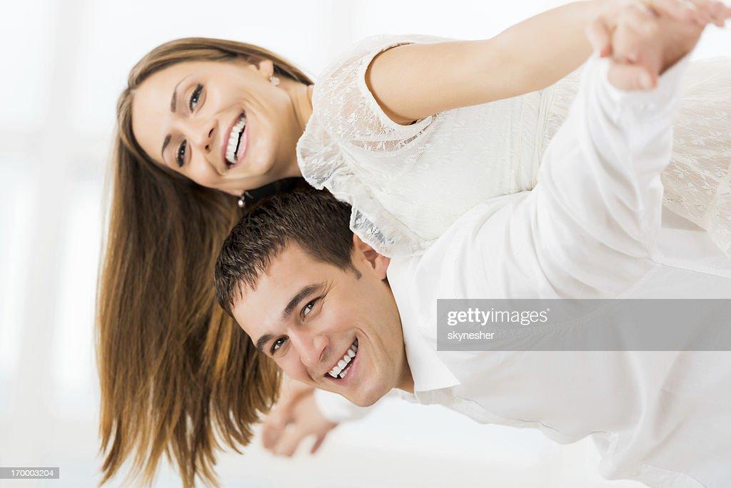 Beautiful young couple piggybacking. : Stock Photo