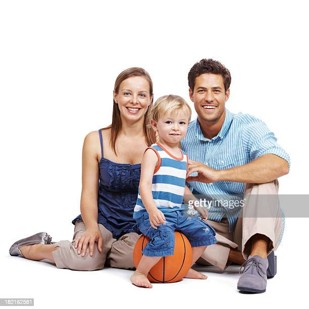 Beautiful, young couple with their cute kid against white background