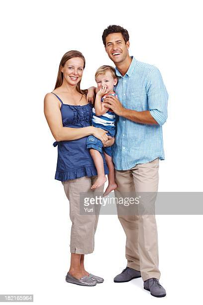 Beautiful, young family portrait on white background
