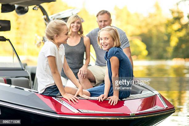 Beautiful young family sits in their ski boat