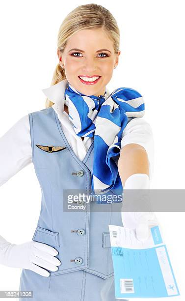 Beautiful young flight attendant holding ticket
