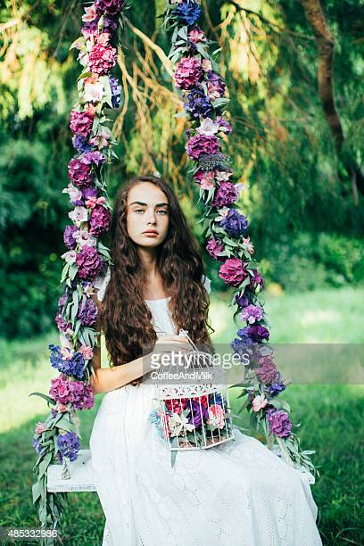 Beautiful young girl on a swing
