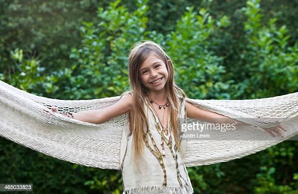 Beautiful young girl smiling in hammock