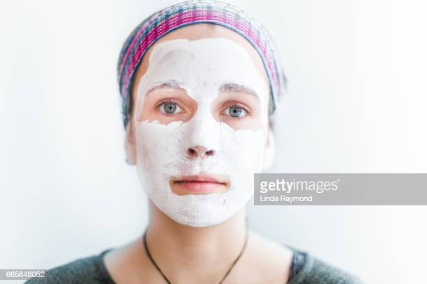 A beautiful young girl with a facial mask and a headban