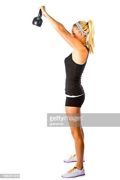 Beautiful Young gym Woman with Kettle Ball