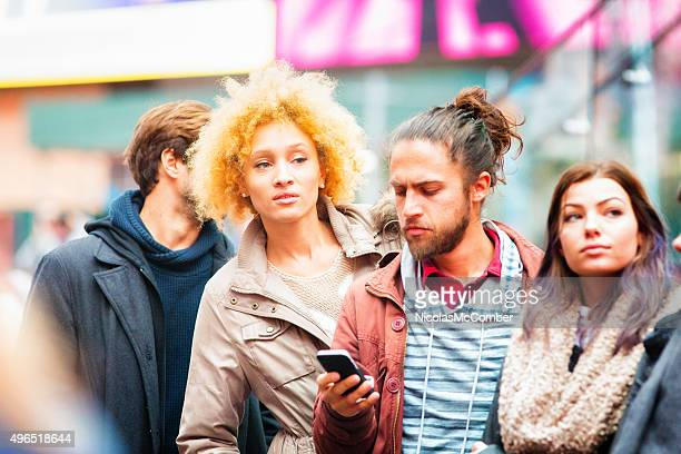Beautiful young hip mixed-race woman getting impatient in line