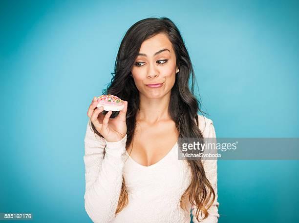 Beautiful Young Hispanic Women With A Cookie