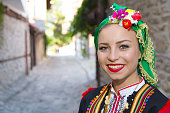 Beautiful young people in national costumes. Concept of identity preservation.