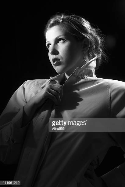 Beautiful young retro woman in trench coat film noir style