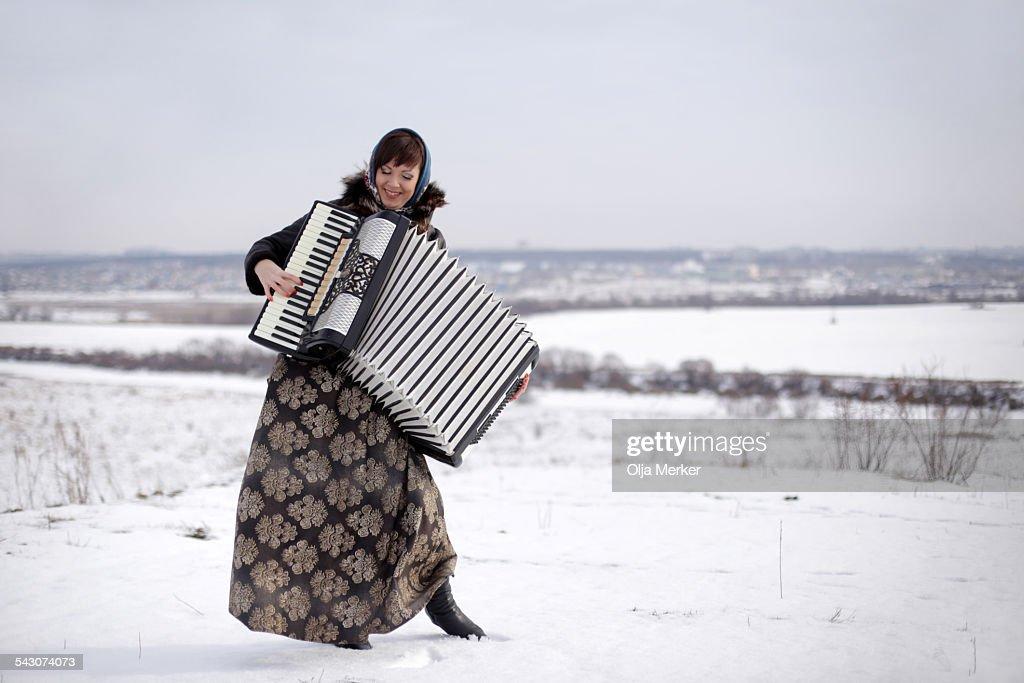 detail photo beautiful young russian woman playing accordion royalty free image