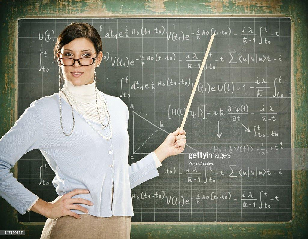 Beautiful young teacher : Stock Photo
