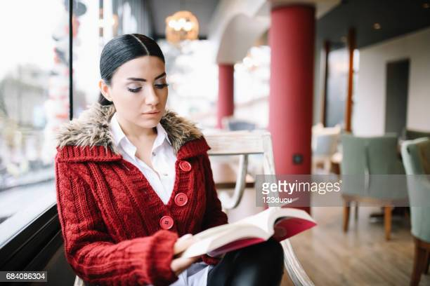 Beautiful Young Woman At CAfe