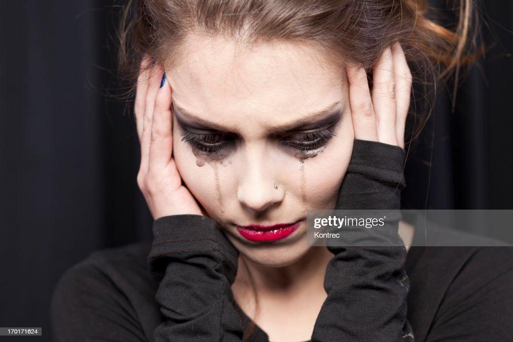 Beautiful young woman crying