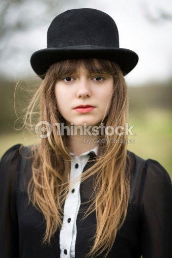 Beautiful Young Woman Dressed In Black Wearing Bowler Hat Stock ... 62b791eeba1f
