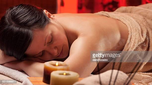 Beautiful young woman enjoying massage treatment