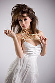 Beautiful Young Woman Fashion Model in White Dress, Pearl Necklace