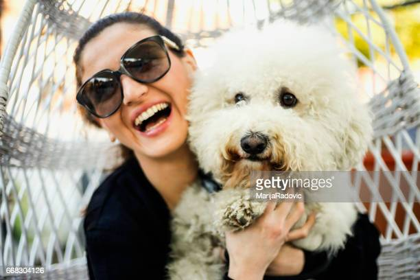Beautiful young woman happy with small dog