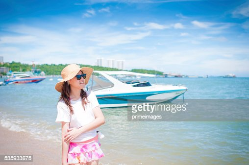 Beautiful young woman having fun on beach : Stock Photo