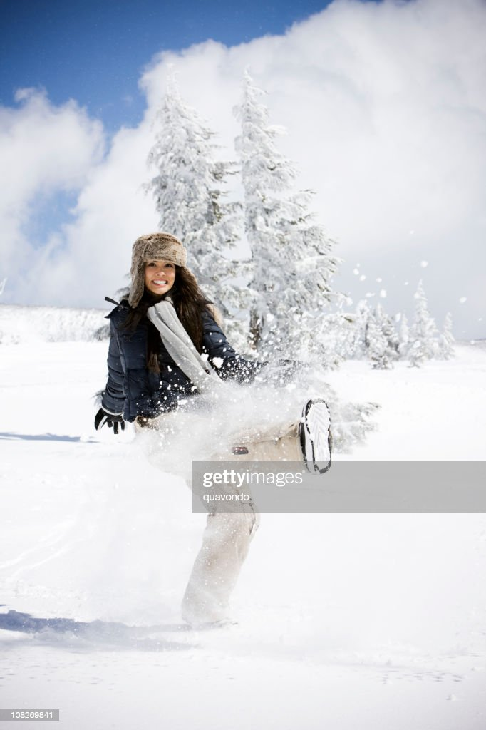 Attractive Young Woman Having Fun on Snowy Mountain, Copy Space : Stock Photo