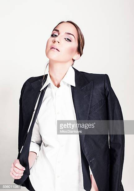 Beautiful young woman in a man's suit