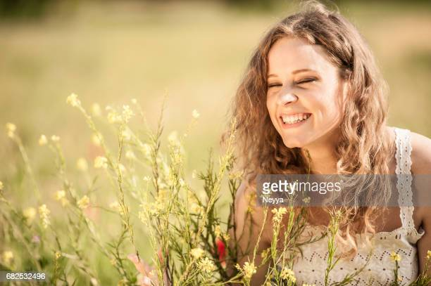 Beautiful Young Woman in a Spring Field