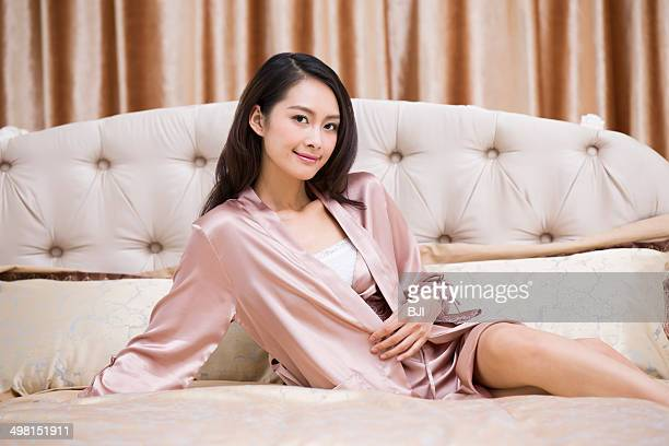 Beautiful young woman in bedroom
