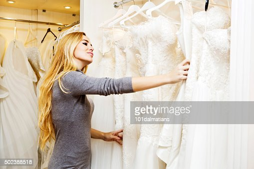 Beautiful young woman in bridal boutique : Stock Photo