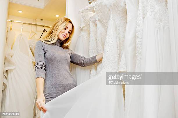 Beautiful young woman in bridal boutique