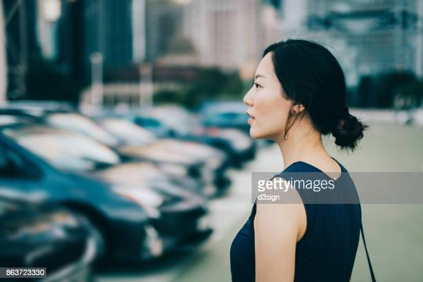 Beautiful young woman in downtown financial district in Hong Kong