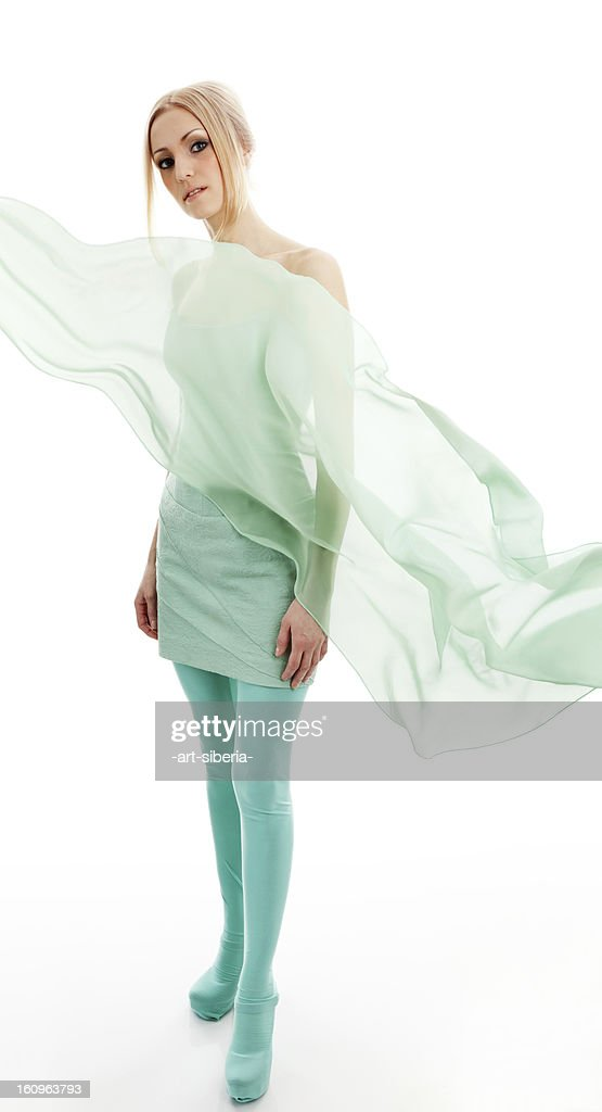 Beautiful young woman in dress : Stock Photo