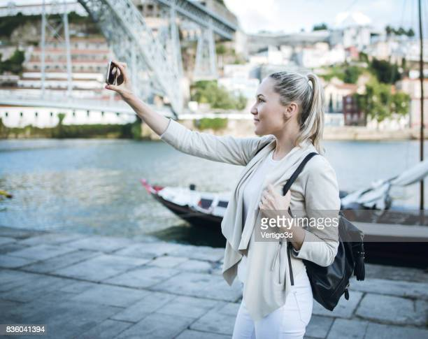 Beautiful young woman in real life, she making selfie