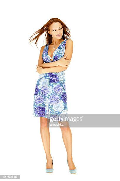 Beautiful Young woman in Summer Dress Posing on White Background