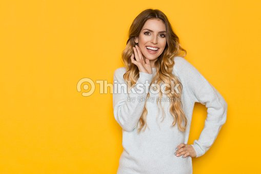 Beautiful Young Woman Is Smiling And Holding Hand On Chin : Stock Photo